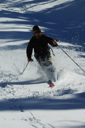A backcountry skier performing a telemark turn