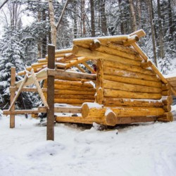 A lean-to under construction in winter