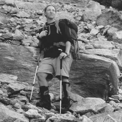 Julia Goren stands on a cliff