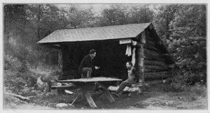 Black and White image of a man in a lean-to
