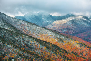 Mountains with fall colors and snow on summits