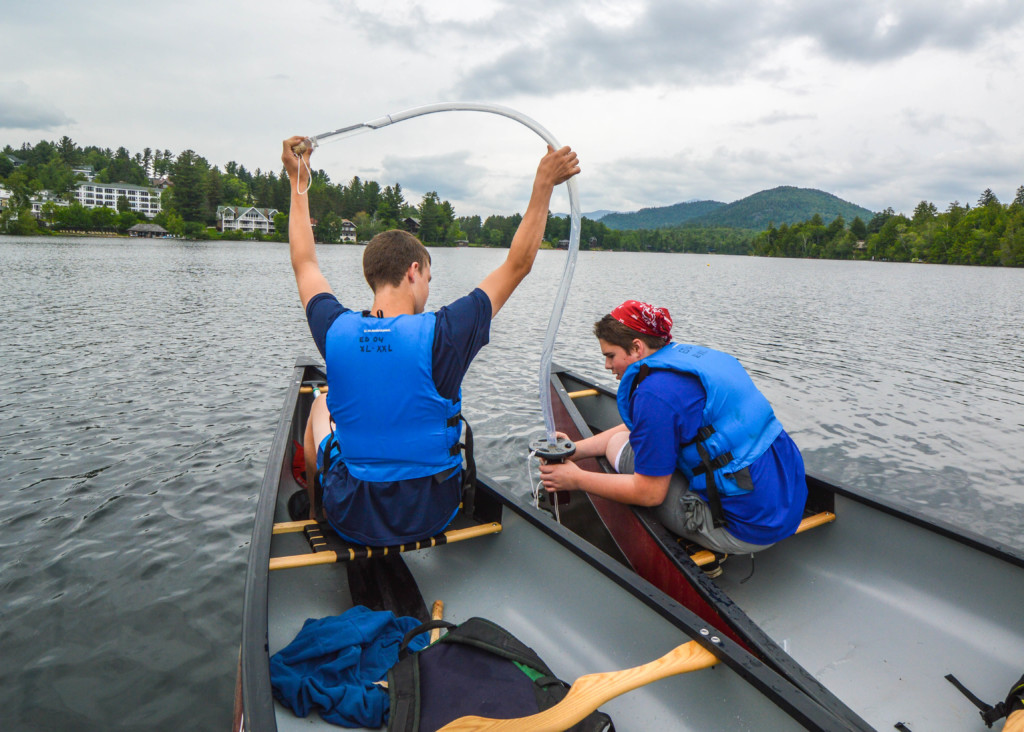 Two teens siphon water from Mirror Lake for sampling