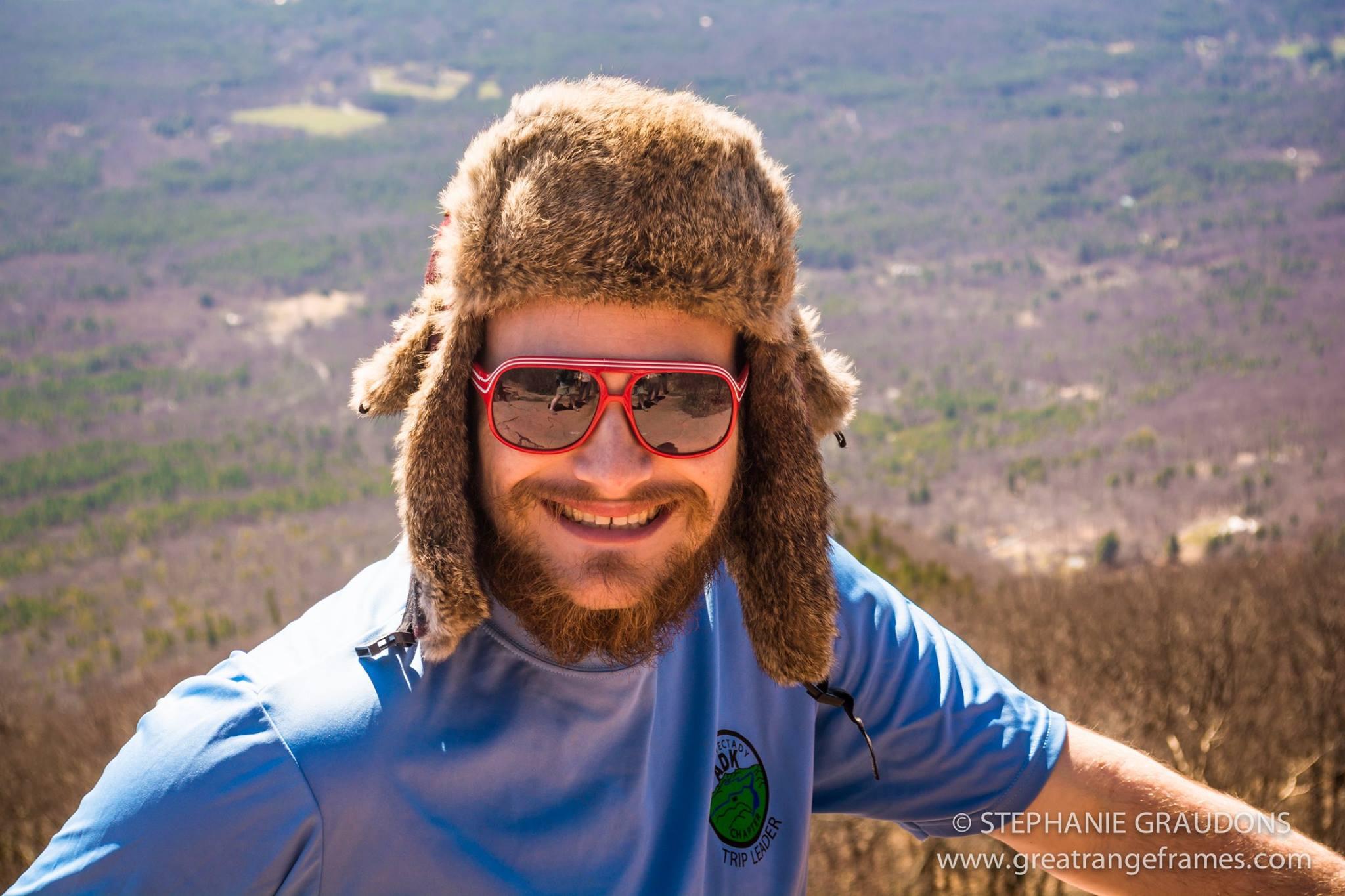 Dustin smiles on an overlook
