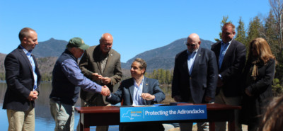 neil shaking governor's hand at signing for boreas ponds