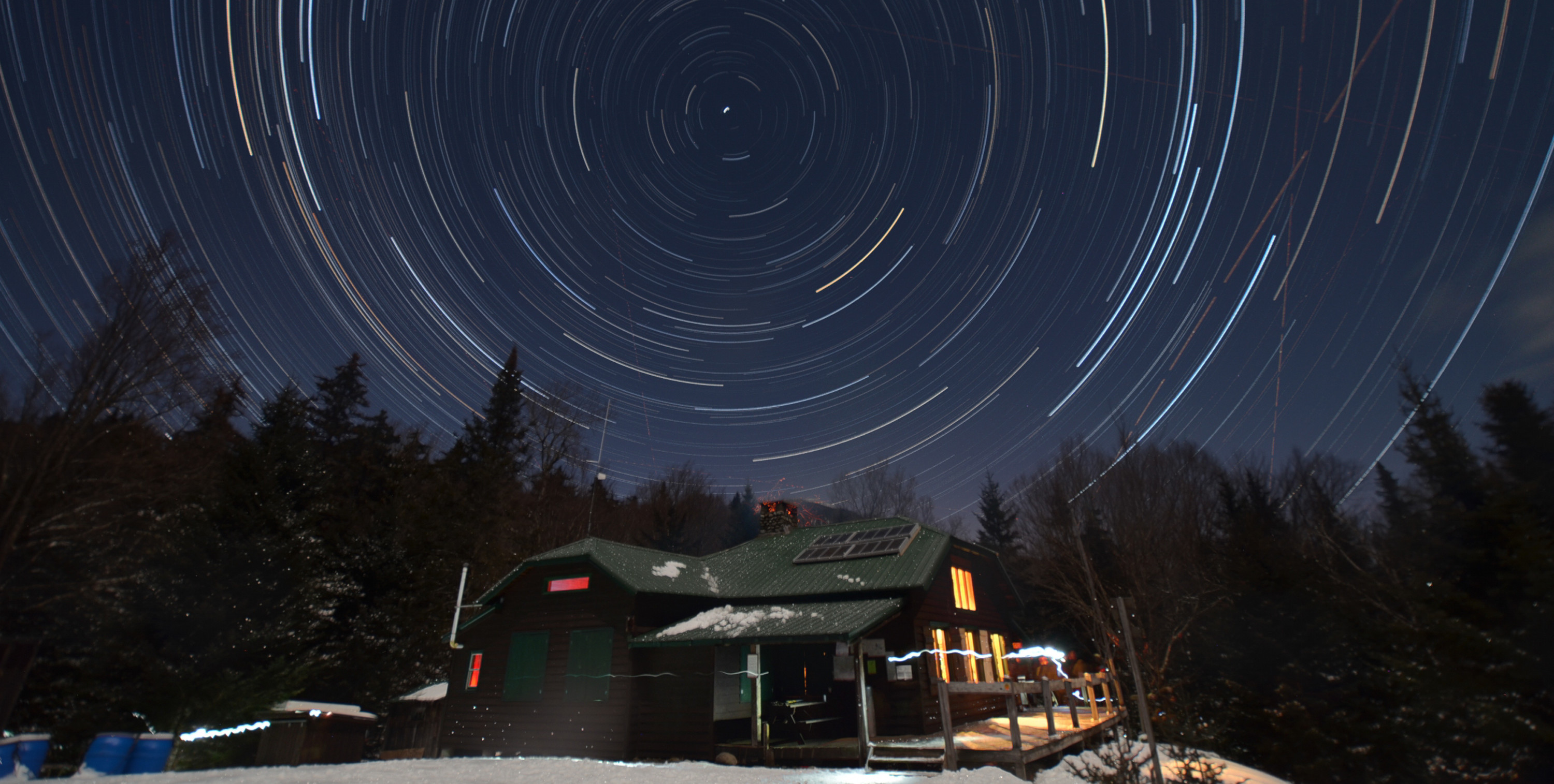 Star trails over Johns Brook Lodge in winter