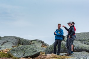 A steward speaks to two hikers