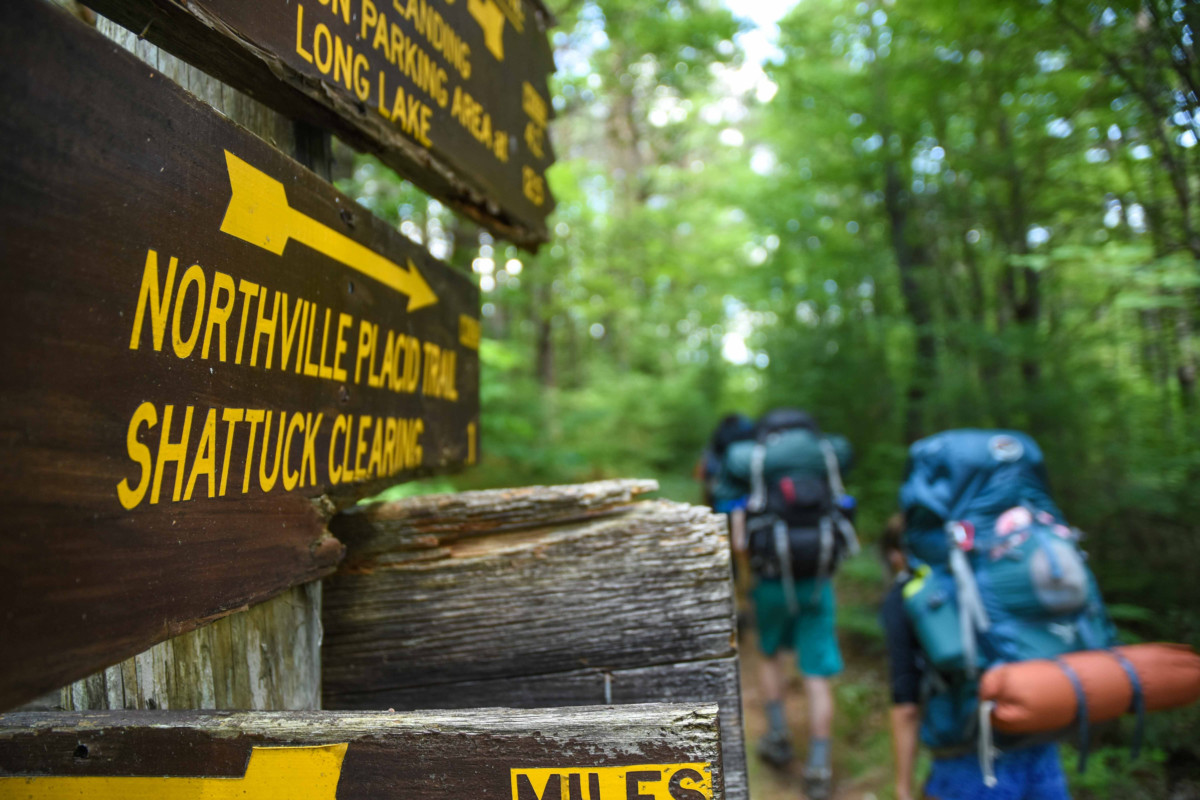 Backpackers hike on the Northville-Placid Trail