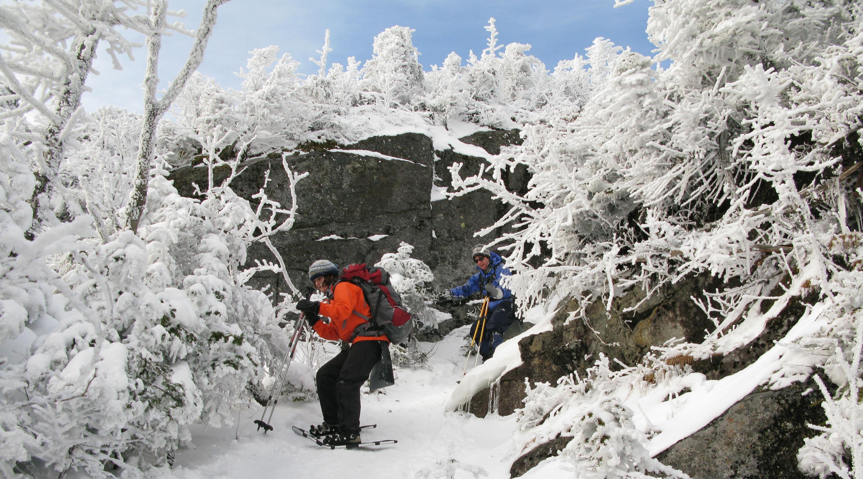 Hikers descend in snow
