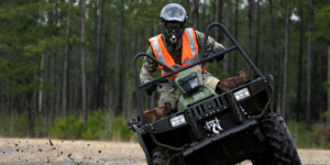 ATV rider churns up mud and dirt in the woods