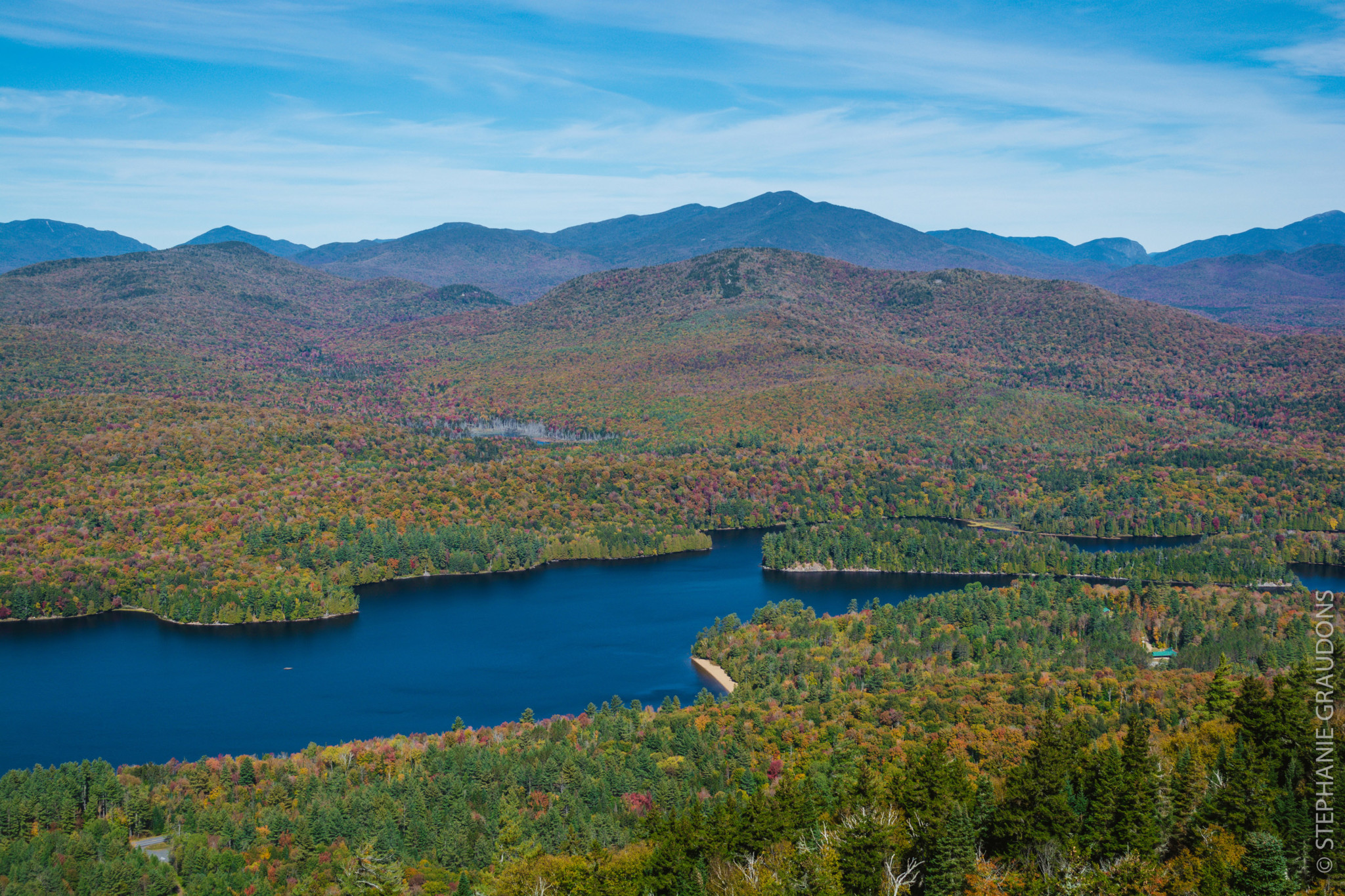 View from top of Goodnow Mountain looking down on valley with blue lake.