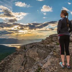 A hiker watches sunset on Sleeping Beauty