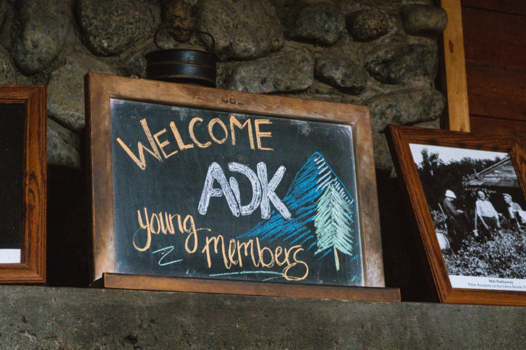 A warm welcome sign by chalkboard and smiling staff!