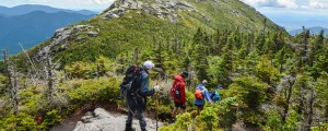 A group of hikers approach Haystack