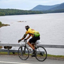 An ididaride participant cycles past a lake view
