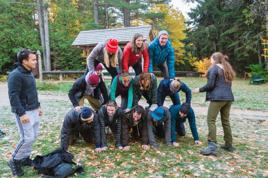 A group making a human pyramid