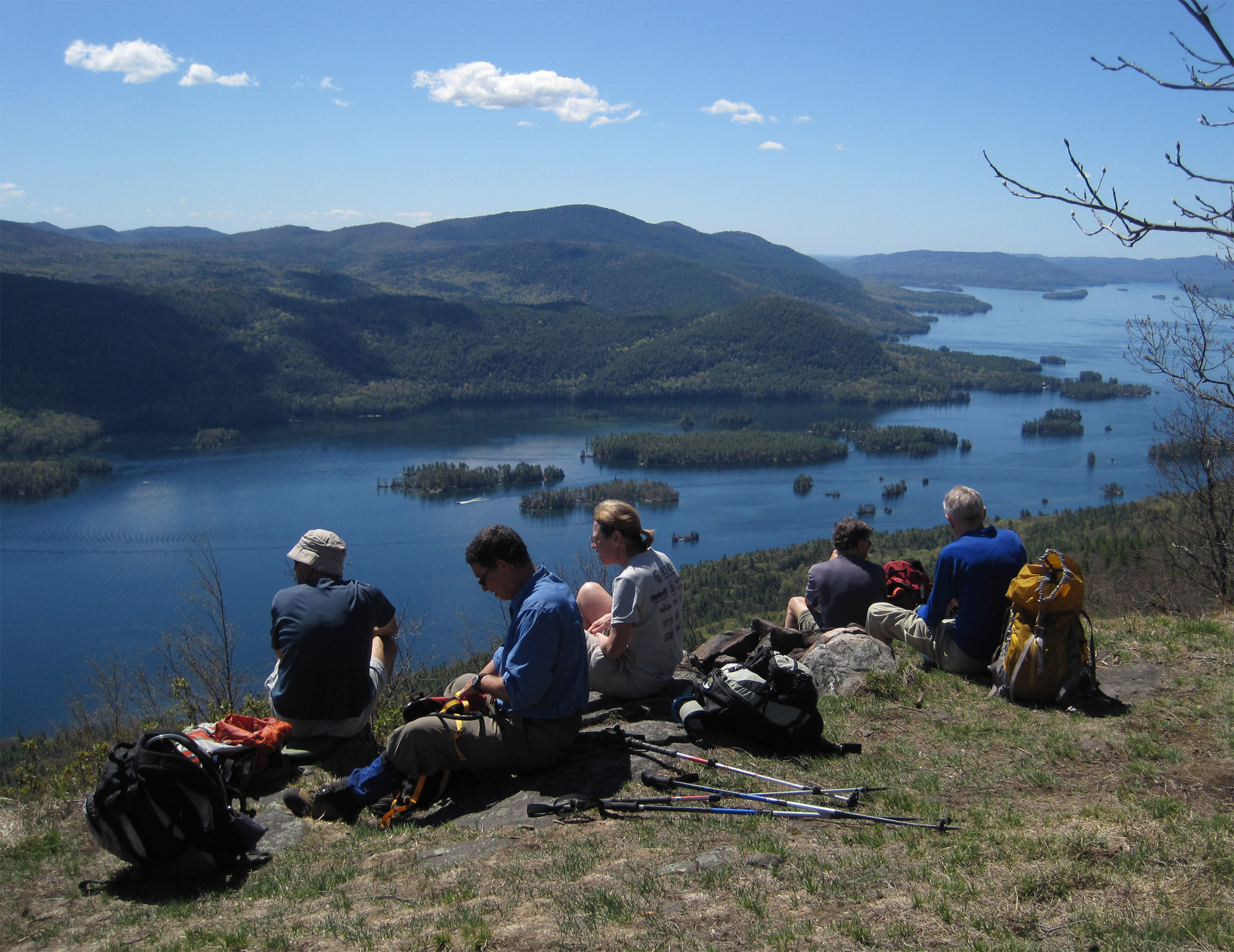 Hikers enjoying a view of Lake George