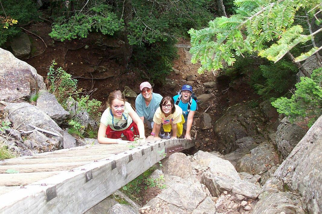 Hikers prepare to climb the ladder Near Summit of Crane Mountain