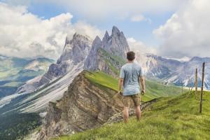 man hiking the Dolomites