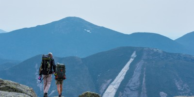 Two hikers walk toward a viewpoint on Algonquin