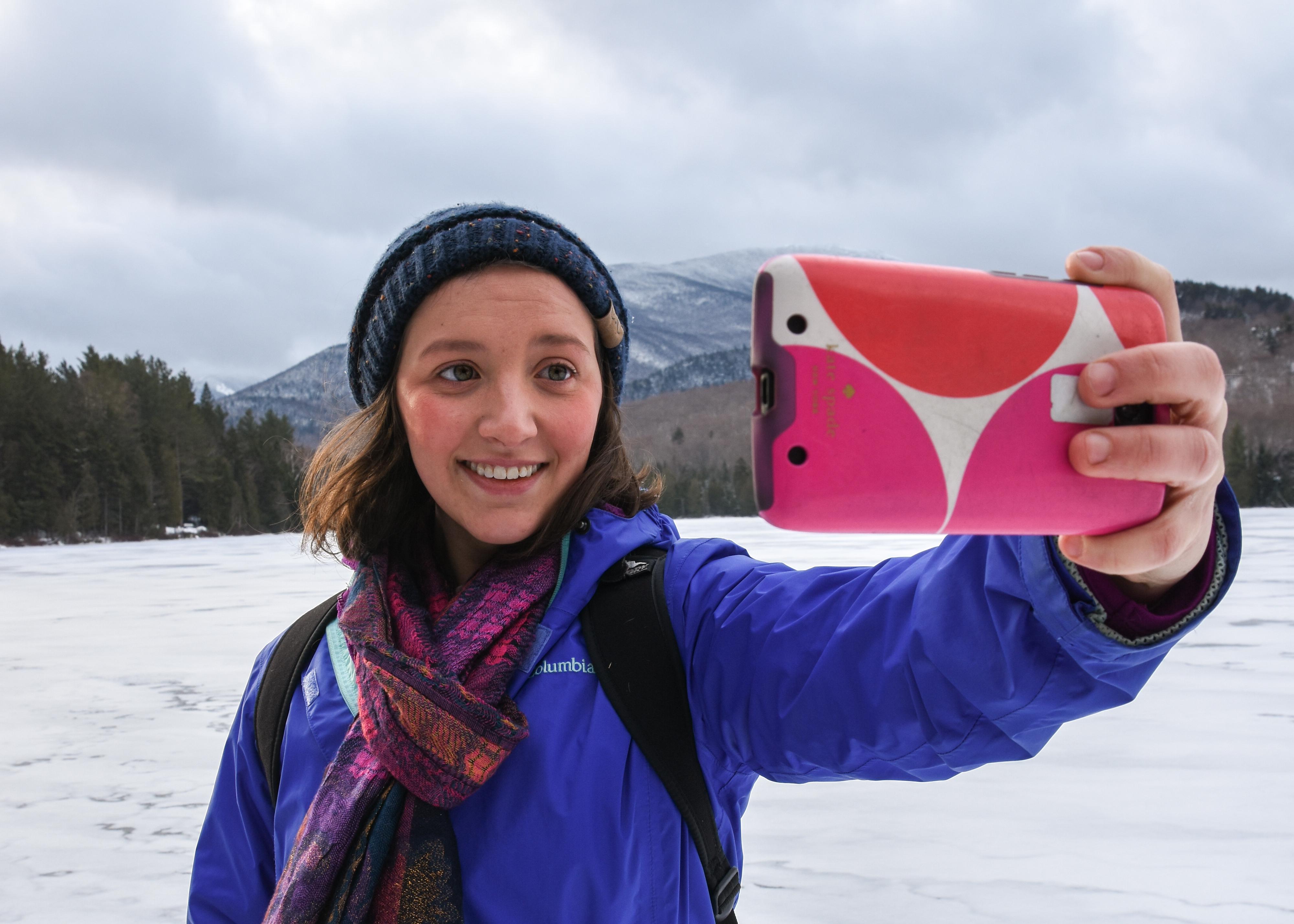 Hiker taking a selfie at Heart Lake