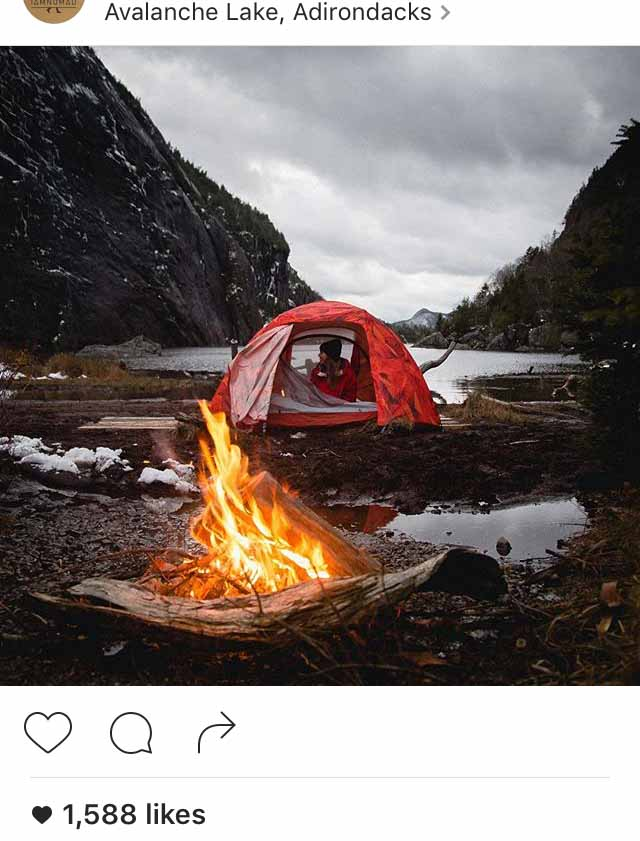 A camper illegally pitching a tent and having a fire at Avalanche Lake