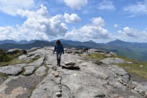 A lone hiker walks along a ridge line