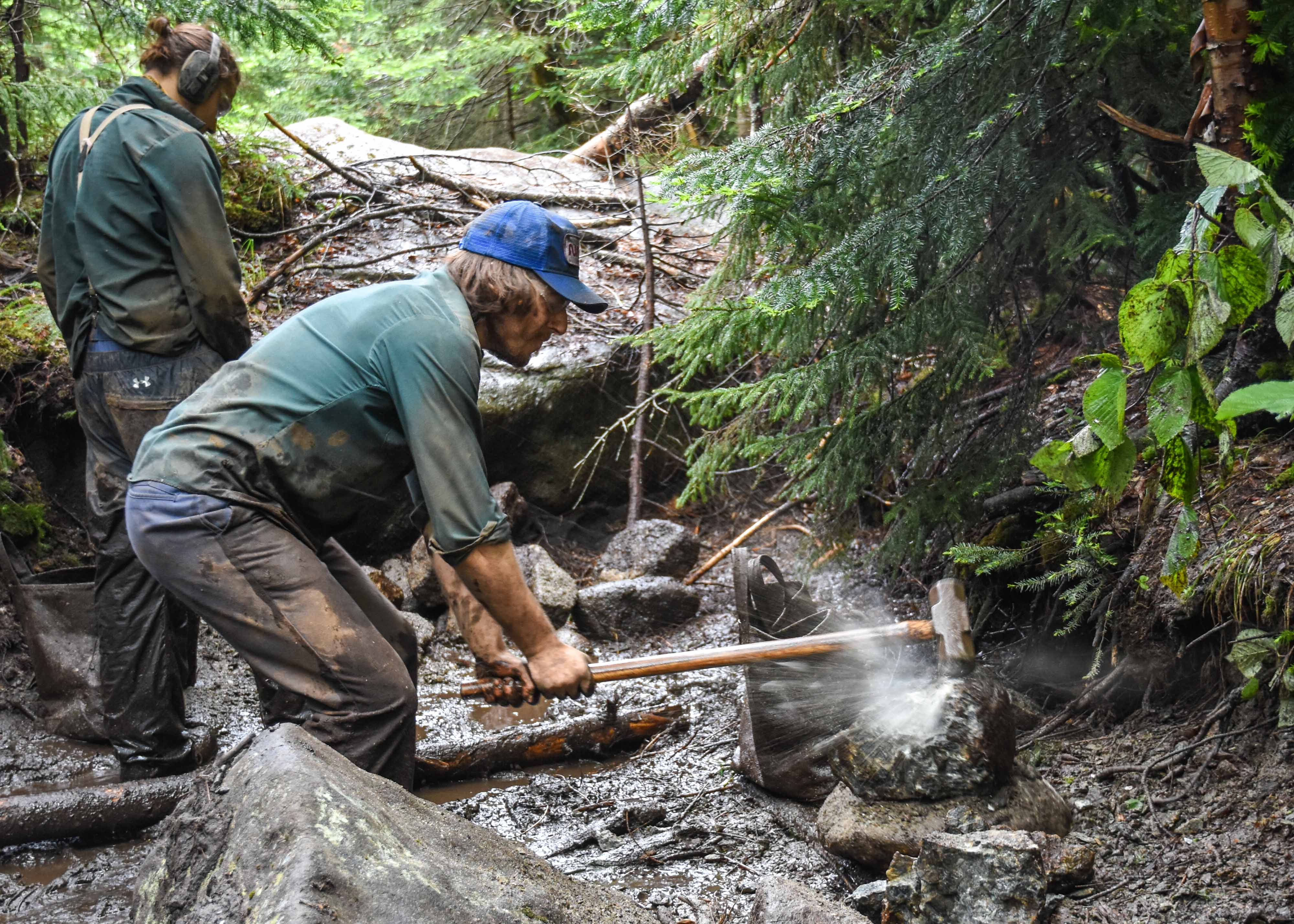 Timothy O'Boyle crushing stone for turnpiking on the trail to Avalanche Lake
