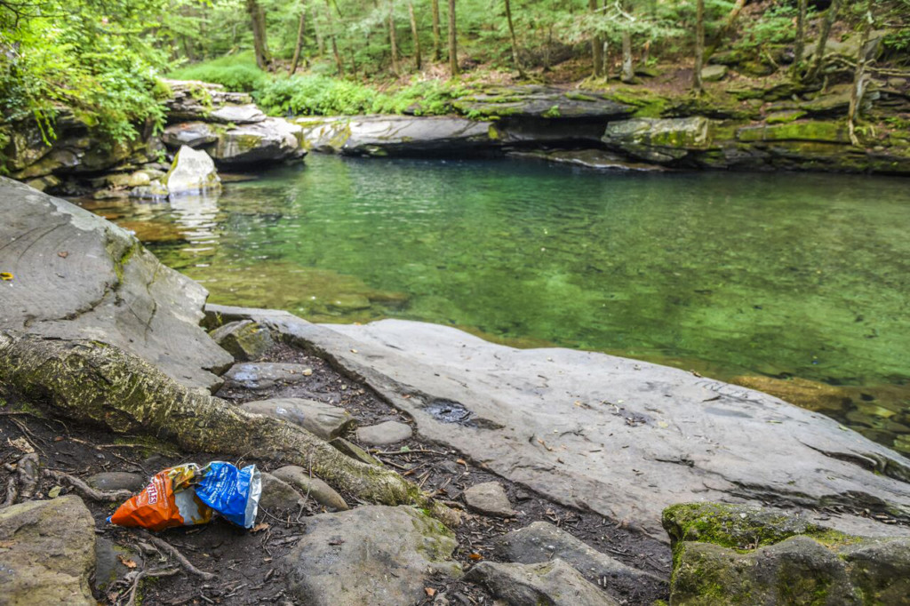 Blue Hole in the Catskills with trash in the foreground