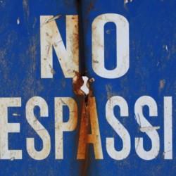 Blue no trespassing sign