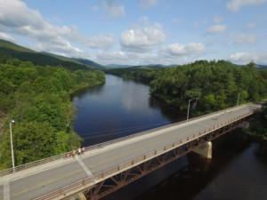 A bird's-eye view of a bridge over a river
