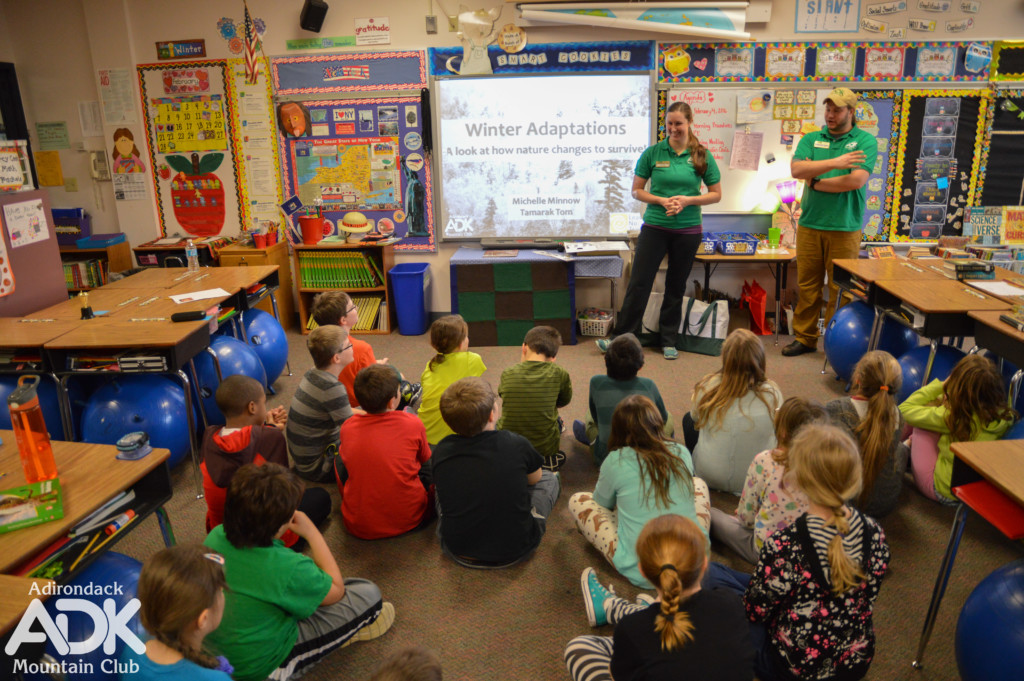 ADK staff speak with a group of third graders in their classroom