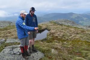 A summit steward speaking with a hiker