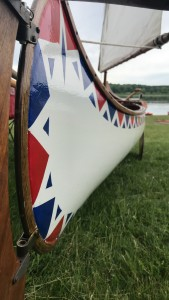 Closeup of a red, white, and blue painted canoe