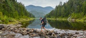 Backpacker near water