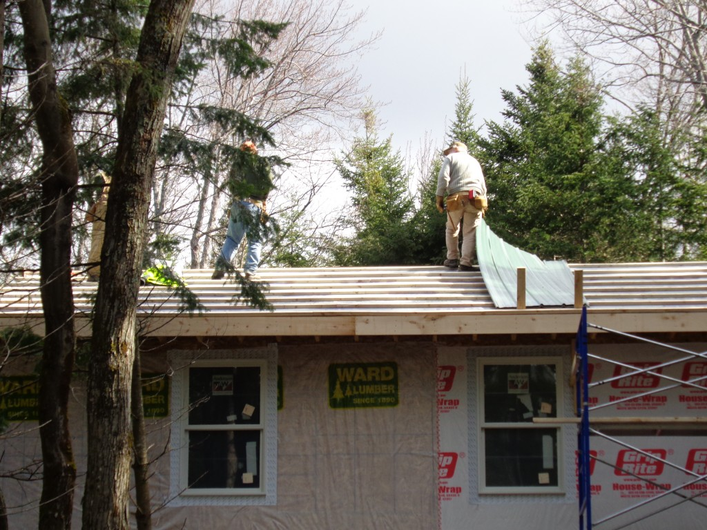 Two men work on the staff cabin roof