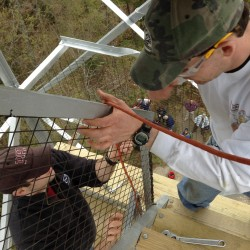 Two men working on a fire tower staircase