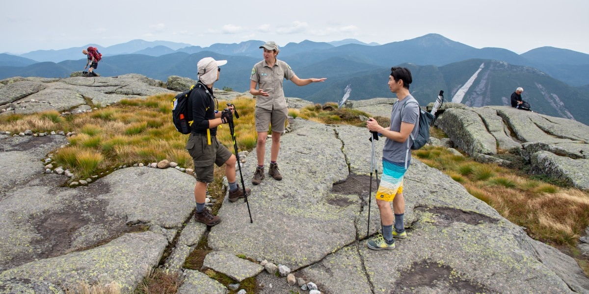 Summit Steward talks to hikers