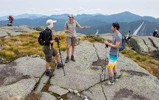 Summit Steward talks to hikers