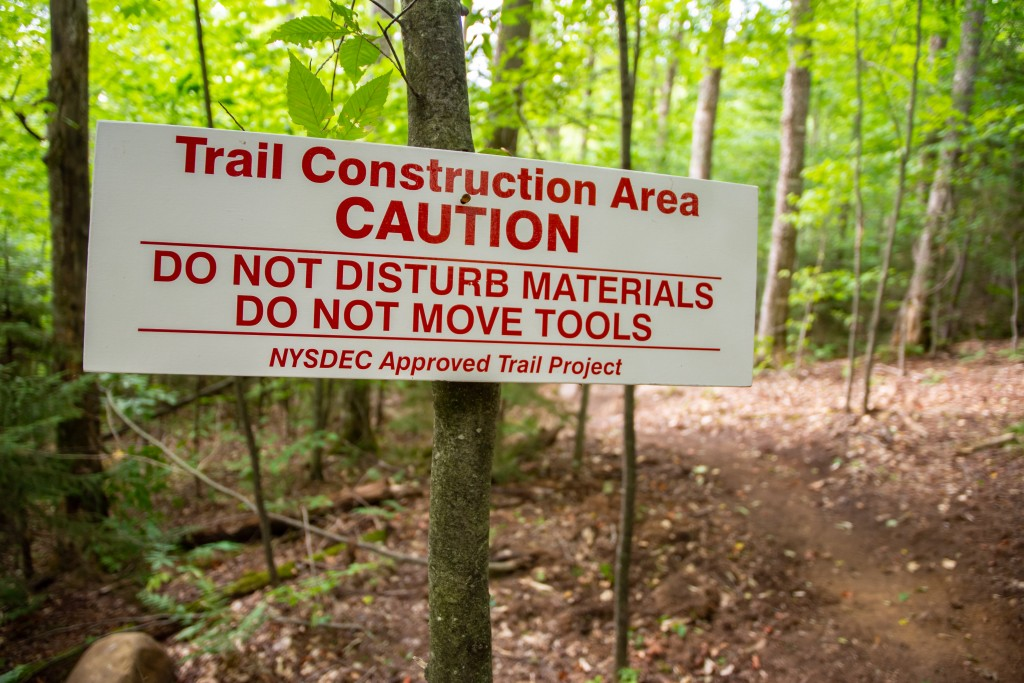 A trail work sign