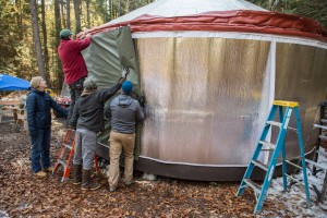 Putting the yurt cover on