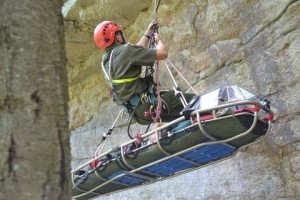 Forest Ranger rappels down cliff with injured hiker