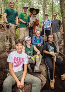 Participants in a trail project pose together