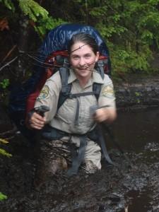 A summit steward stuck in waist deep mud
