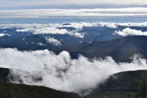 Clouds rolling over mountain tops