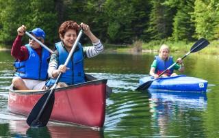 Three paddlers heading upstream