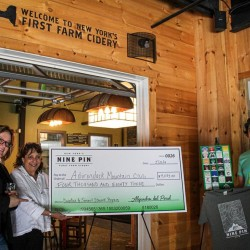 Nine Pin Cider presents a check to ADK