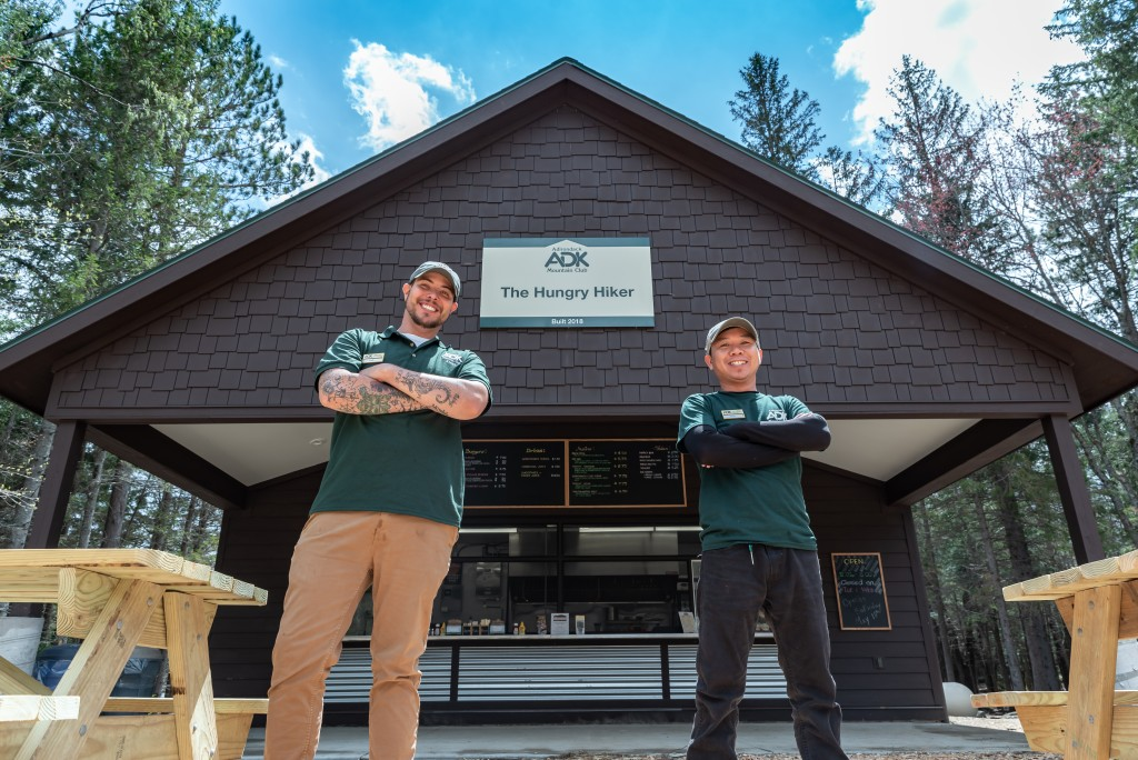 Two Hungry Hiker staff pose in front of the new facility