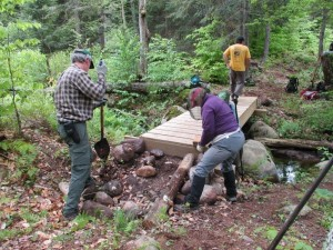 Volunteers do trail maintenance on the new trail
