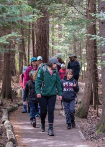 Kids and adults on a trail