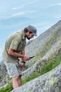 The botany steward studying alpine vegetation